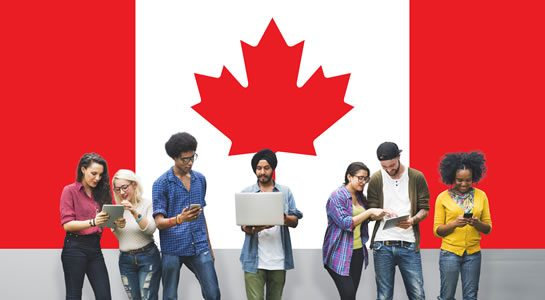Students in front of Canadian flag