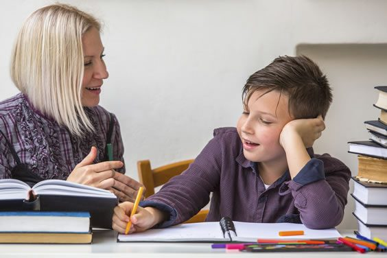 Female Tutor with Young Male Student