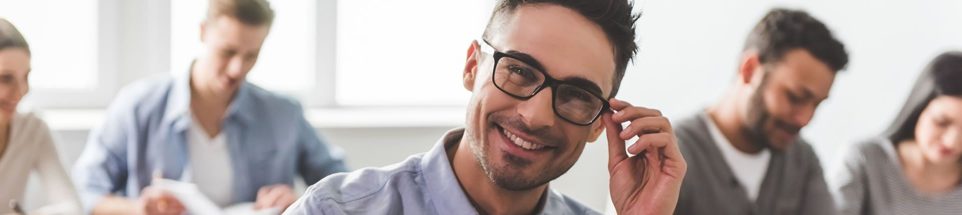 Student smiling with glasses
